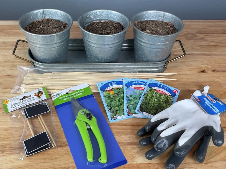 Flower pots Dirt Skewers Seed packets Garden markers Garden gloves Pruners Utensils