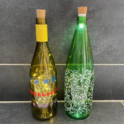 What can you do with glass bottles? Upcycle them with bottle painting and there are so many ways to use the bottle.