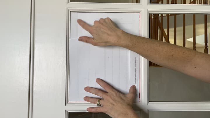 Next I made a template with some scratch paper. This would help me cut the cellophane to the right size to fit within the windows.