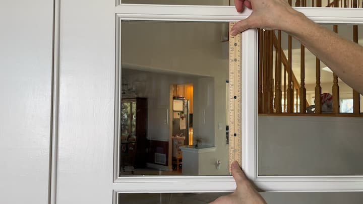 We have some French doors in our home that lead to our office. My husband started working from home full time and we wanted to create a little more privacy as he was participating in his video calls. I started by measuring the windows.