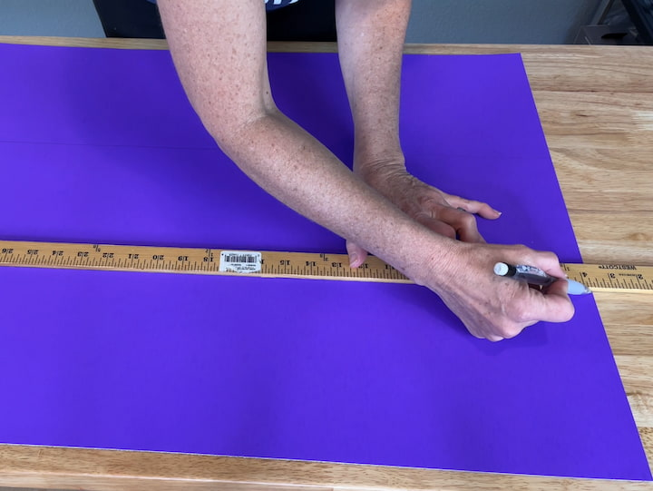 I bought 4 different colors of poster board. For each one, I measured and marked 7.3 inches so that it made 2 marks on each side. I then lined up my yardstick and drew a line across from one dot to the other.